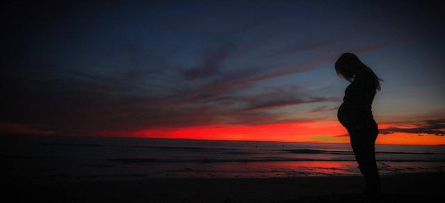 pregnant beach sunset